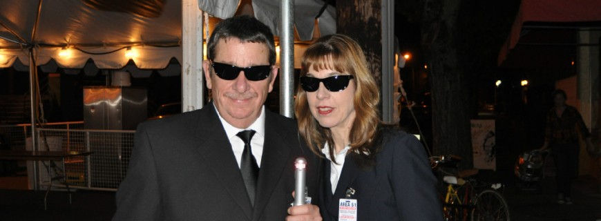 James & Joanne Clarkson at the Mcminnville, Oregon UFO festival dressed as MIB